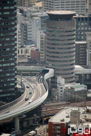 عبور حیرت انگیز بزرگراه از داخل یک ساختمان+عکس